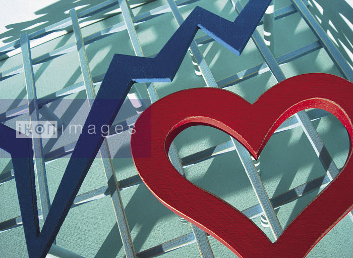 Red painted wooden heart on trellis with blue line graph - Red painted wooden heart on trellis with blue line graph - Andy Bridge