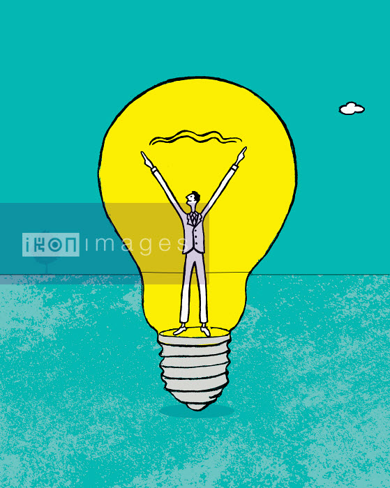 Happy businessman forming connection inside of light bulb - Happy businessman forming connection inside of light bulb - Gary Bates