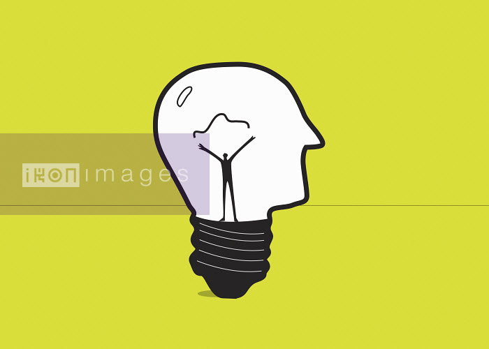Man forming electric filament inside of human head light bulb - Man forming electric filament inside of human head light bulb - Gary Bates