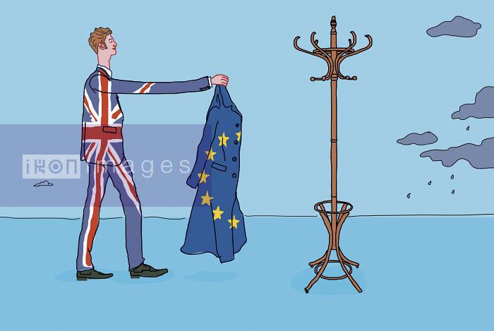 Man wearing union jack suit and hanging up European Union overcoat - Gary Bates
