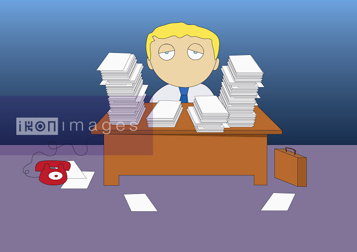 Businessman sitting with stacks of paperwork - Businessman sitting with stacks of paperwork - Oscar Armelles