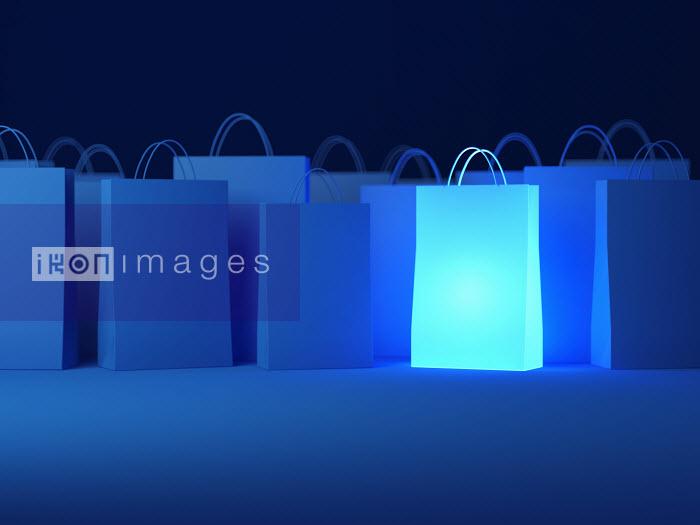 Glowing shopping bag among blue bags - Glowing shopping bag among blue bags - Justin Metz