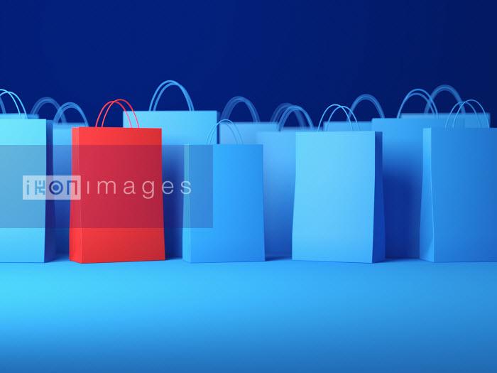 Red shopping bag among blue bags - Red shopping bag among blue bags - Justin Metz