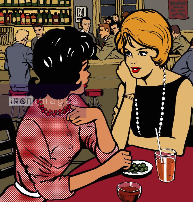 Women friends having drink in bar - Women friends having drink in bar - Jacquie Boyd
