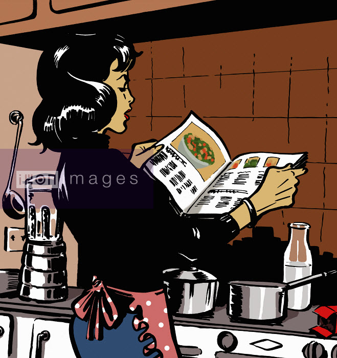 Woman reading cookbook in kitchen - Woman reading cookbook in kitchen - Jacquie Boyd