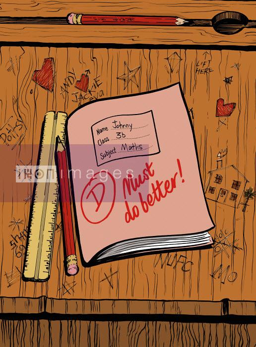 Ikon Images Grade D on maths exercise book on school desk ...
