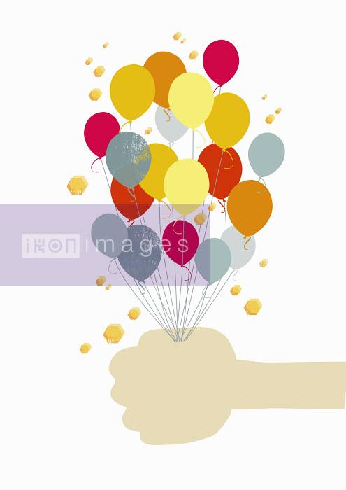 Yee Ting Kuit - Hand holding bunch of colorful balloons
