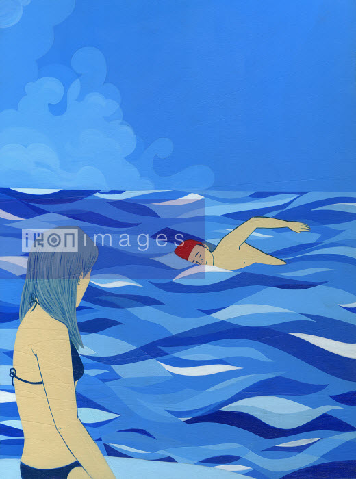Woman watching man swim in ocean - Woman watching man swim in ocean - Katherine Siy