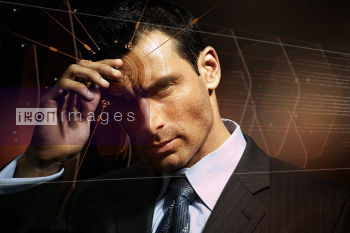 Arrows and lines pointing to businessman�s forehead - Arrows and lines pointing to businessman�s forehead - Aeriform & Christopher Robbins