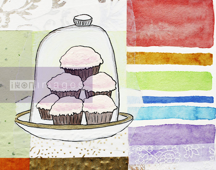 Stephanie Levy - Cupcakes stacked under cake dome