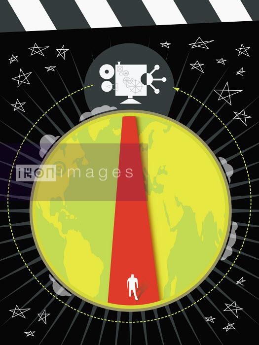 Spotlight on man at base of globe - Spotlight on man at base of globe - James Turner