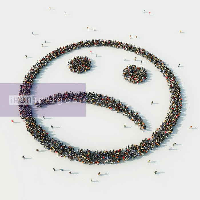 Aerial view of crowd of people arranged in sad smiley face - Aerial view of crowd of people arranged in sad smiley face - Jurgen Ziewe