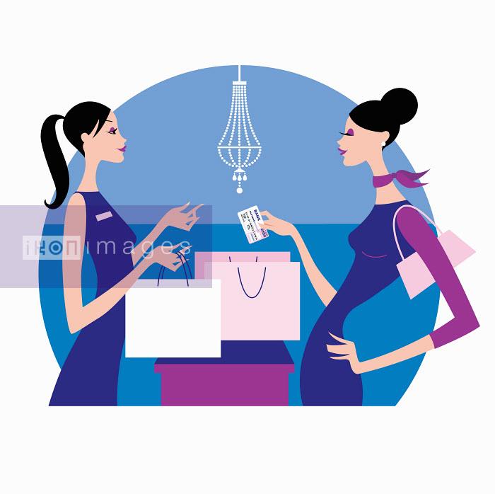Woman handing store clerk credit card - Woman handing store clerk credit card - Arlene Adams
