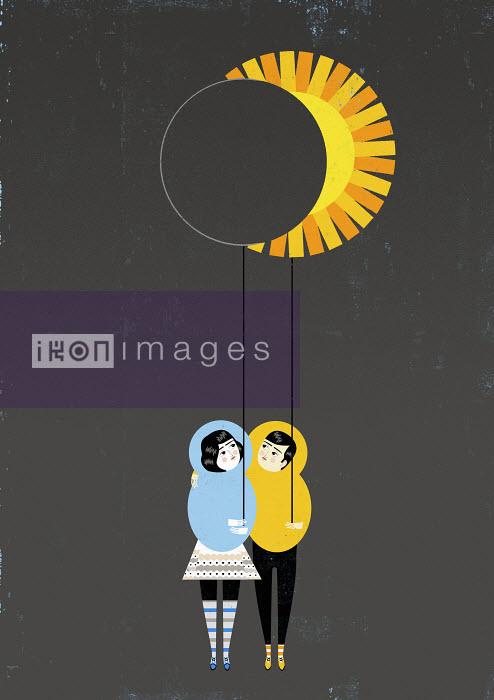 Luciano Lozano - Couple holding moon and sun-shaped balloons