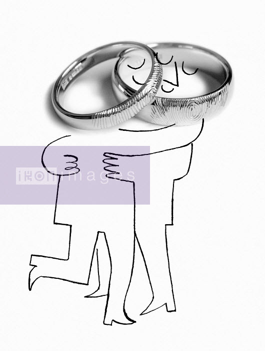 Married couple hugging with wedding ring-shaped heads - Married couple hugging with wedding ring-shaped heads - Luciano Lozano