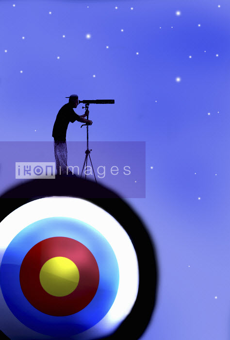 Man with telescope standing on target looking at stars - Man with telescope standing on target looking at stars - Gary Waters