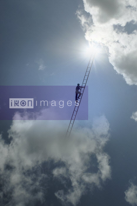 Man climbing ladder between clouds in the sky - Man climbing ladder between clouds in the sky - Gary Waters
