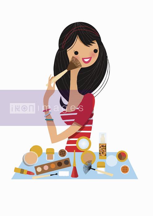 Nila Aye - Smiling woman applying makeup
