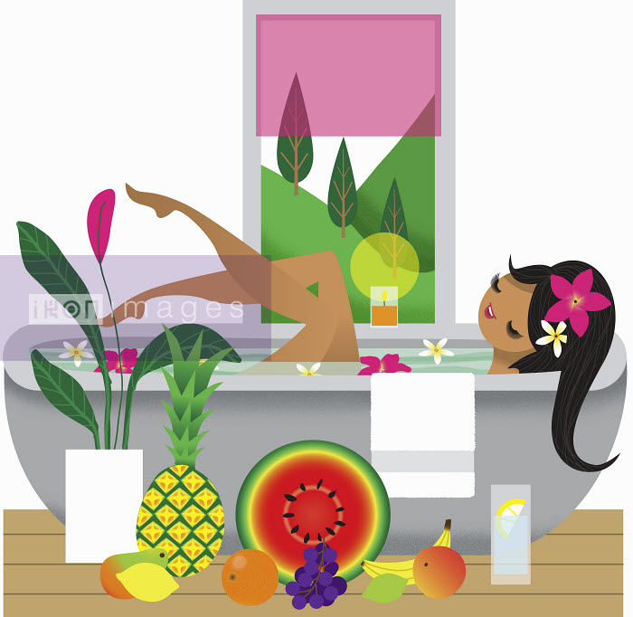 Nila Aye - Happy woman soaking in bathtub surrounded by fruit
