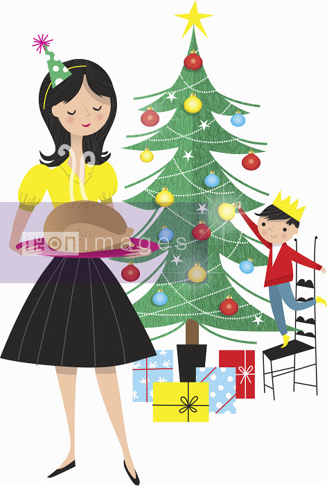 Nila Aye - Mother holding turkey on tray with boy decorating Christmas tree