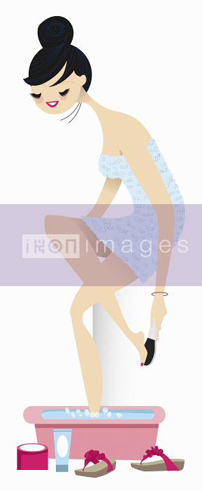 Nila Aye - Woman pampering herself pedicure