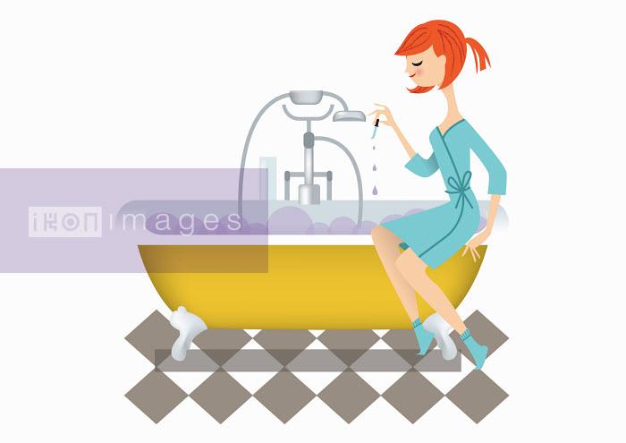 Nila Aye - Woman dropping essential oils into bubble bath