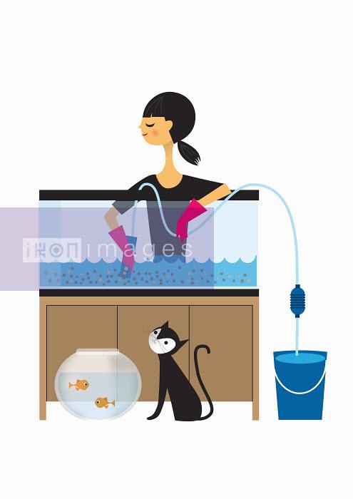 Nila Aye - Woman cleaning out fish tank