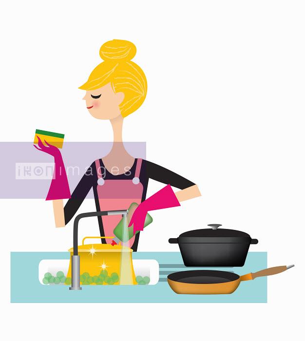 Nila Aye - Woman washing pans in kitchen sink