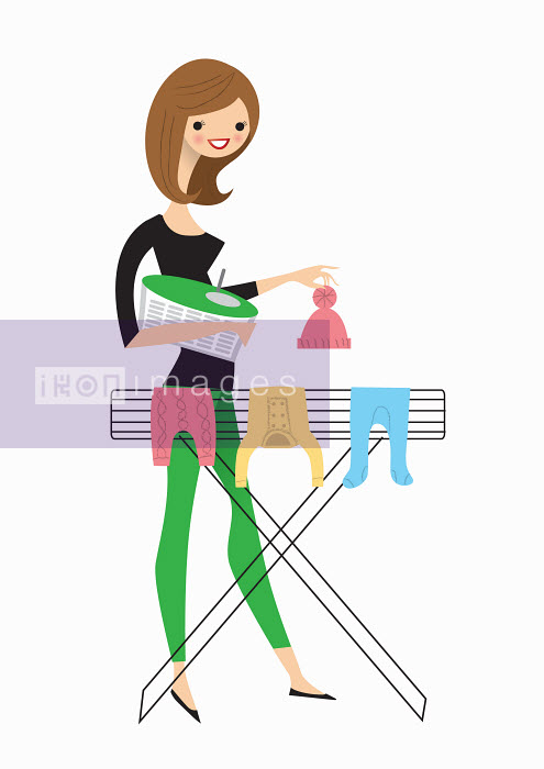Nila Aye - Woman hanging baby clothes on airer