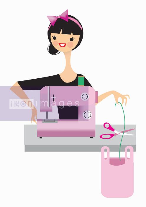 Nila Aye - Woman using sewing machine