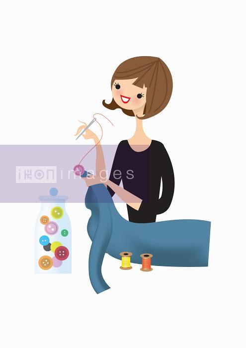 Woman sewing button on dress - Nila Aye