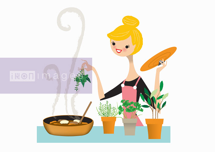 Woman adding fresh herbs to pan - Nila Aye