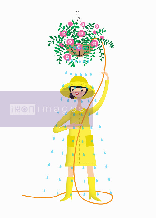 Woman wearing rain hat, raincoat and wellingtons to water hanging basket - Nila Aye