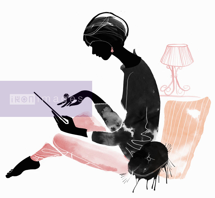 Mette Boesgaard - Elegant woman using digital tablet in living room