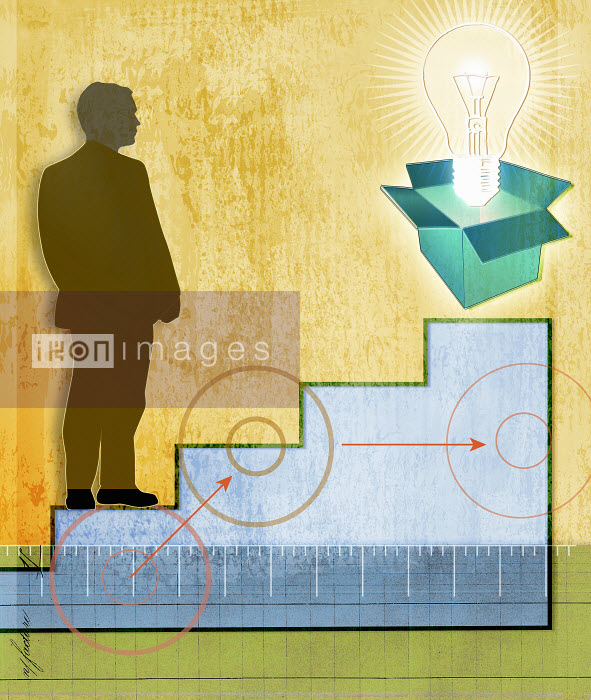 Businessman on staircase looking at light bulb emerging from box - Businessman on staircase looking at light bulb emerging from box - Roy Scott