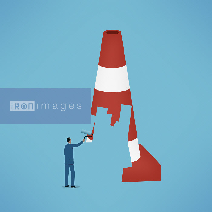 Mark Airs - Man paints over a road cone to remove the barrier