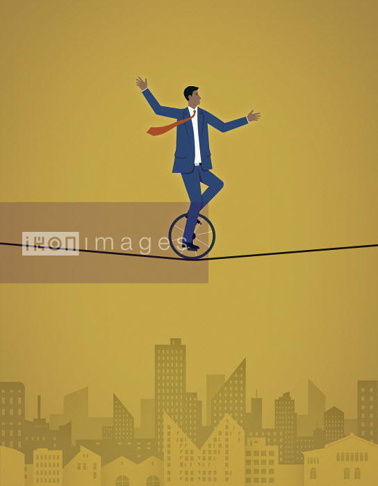 Mark Airs - Man rides accross a tightrope on a unicycle