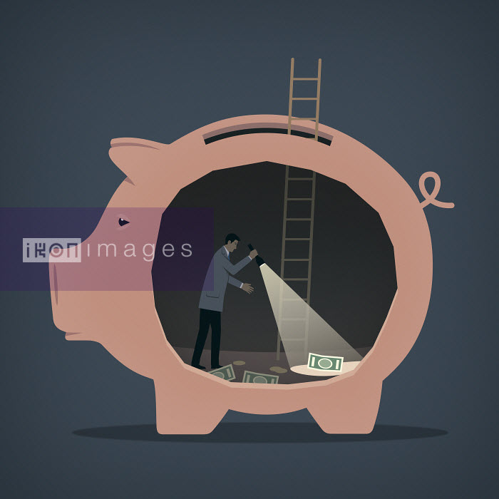 Mark Airs - Businessman searches for money in a piggybank