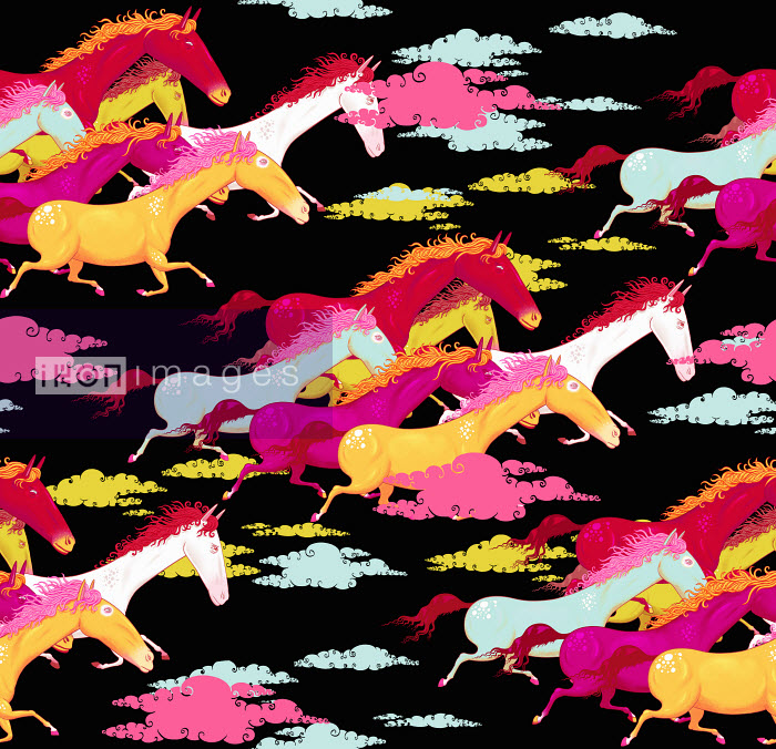 Andy Ward - Full frame pattern of multicolored horses running with dust clouds