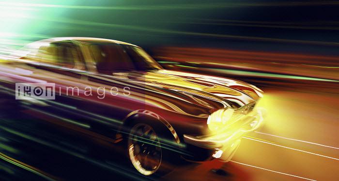 Shiny car moving at speed at night - Shiny car moving at speed at night - Ian Cuming