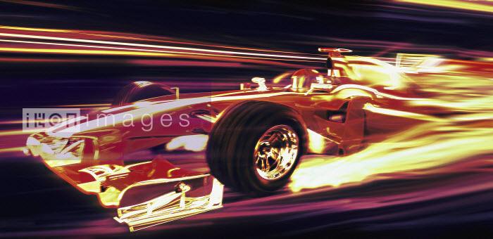 Formula one racing car moving at speed at night - Formula one racing car moving at speed at night - Ian Cuming