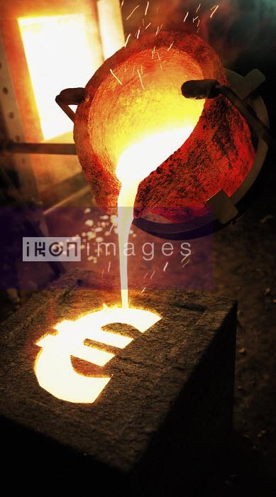 Molten metal pouring into euro sign mold - Molten metal pouring into euro sign mold - Ian Cuming