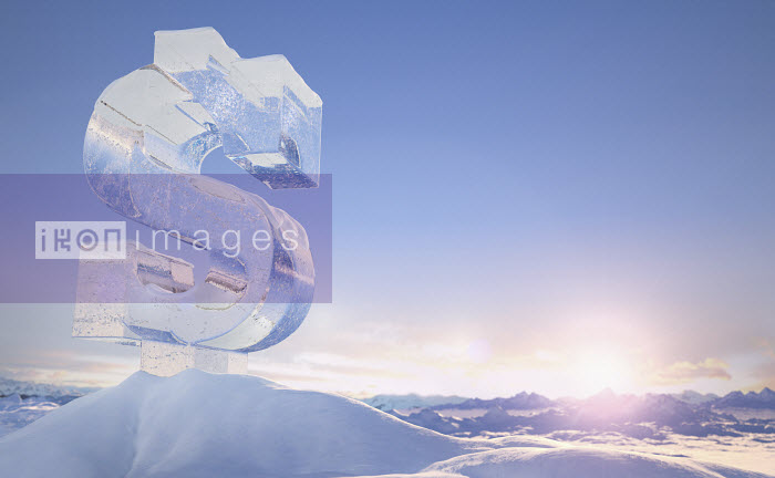 Frozen dollar sign on top of mountain peak in snowy landscape at sunrise - Frozen dollar sign on top of mountain peak in snowy landscape at sunrise - Ian Cuming
