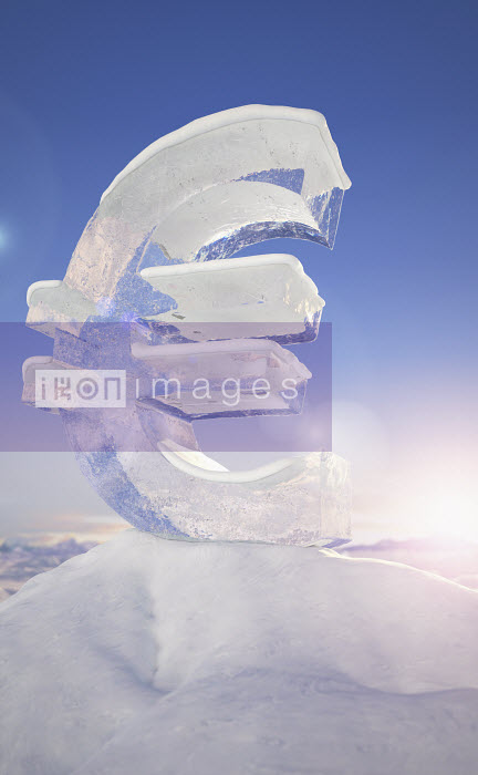 Frozen euro sign on top of mountain peak in snowy landscape at sunrise - Frozen euro sign on top of mountain peak in snowy landscape at sunrise - Ian Cuming