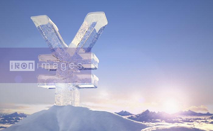 Frozen yen sign on top of mountain peak in snowy landscape at sunrise - Frozen yen sign on top of mountain peak in snowy landscape at sunrise - Ian Cuming