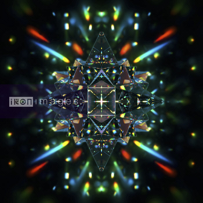 Abstract symmetrical pattern of multicolored light trails and crystal pyramid shapes - Abstract symmetrical pattern of multicolored light trails and crystal pyramid shapes - Ian Cuming