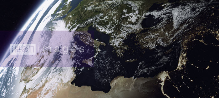 Digitally manipulated image of the Mediterranean Sea from space with day over Europe and night over the Middle East - Ian Cuming