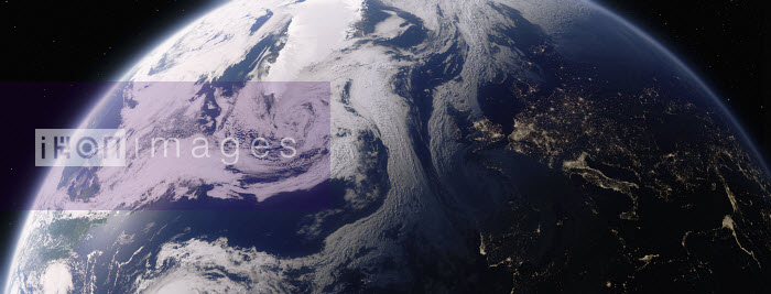 Digitally manipulated image from space with day over the North Atlantic Ocean and night over Europe - Ian Cuming