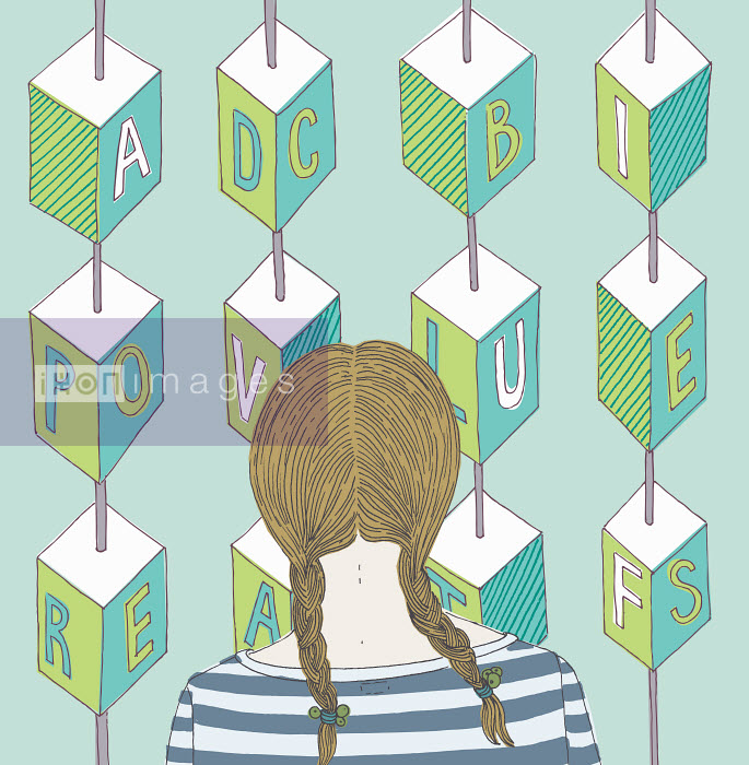 Girl looking at alphabet blocks - Girl looking at alphabet blocks - Trina Dalziel