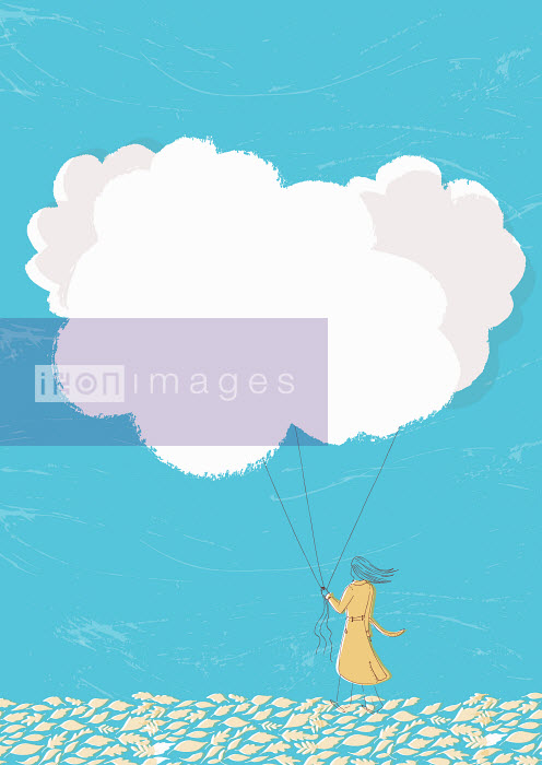 Woman holding cloud balloons on string - Woman holding cloud balloons on string - Trina Dalziel